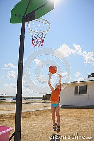 Boy throwing ball to basket