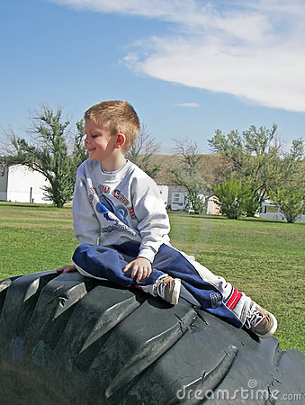 Boy on tire.