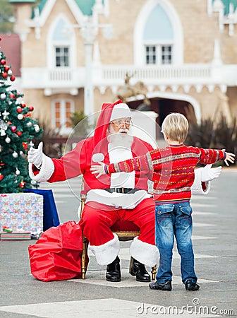 Boy About To Embrace Santa Claus