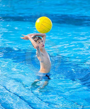Boy about to hit a ball in swimming pool