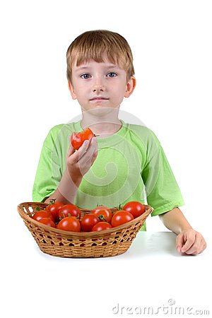 Boy with tomatoes