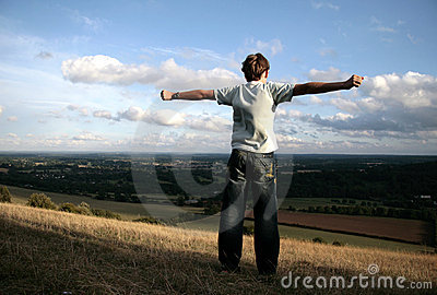 Boy on the top of hill
