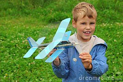 Boy with toy airplane in hands