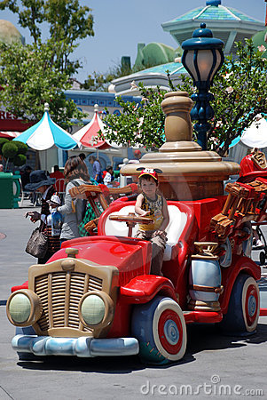Boy in the toy car in mickey s toontown Editorial Stock Image