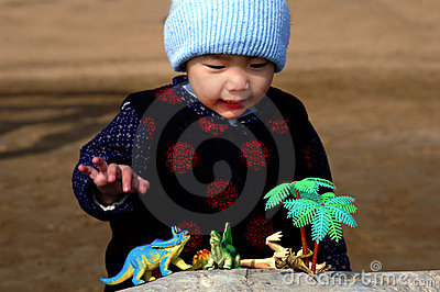 Boy and toy dinosaurs
