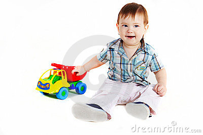 Boy with toy truck