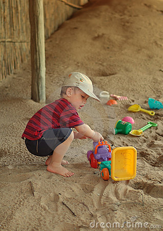 Boy and toys on beach
