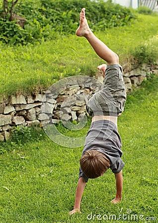 Boy training handstand