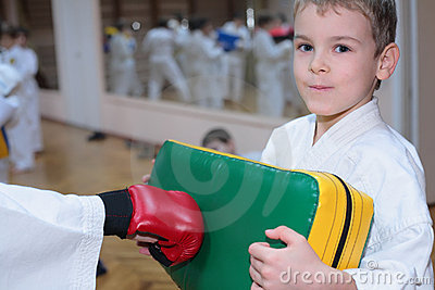 Boy trains in sports hall