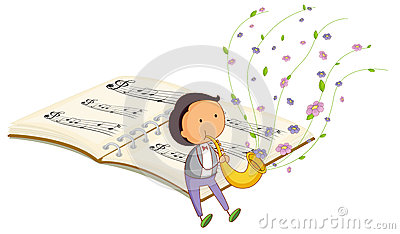 A boy with a trumpet and a music book at the back