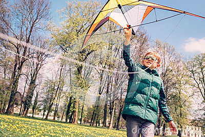Boy try to start fly kite Stock Photo
