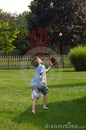 Free Boy Trying To Catch Ball Stock Photography - 1244542