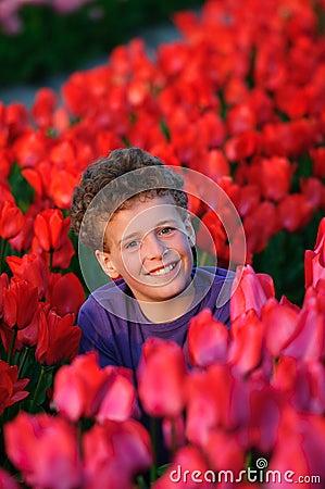 Boy in tulips field