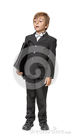 Boy in a tuxedo with a folder in hands.