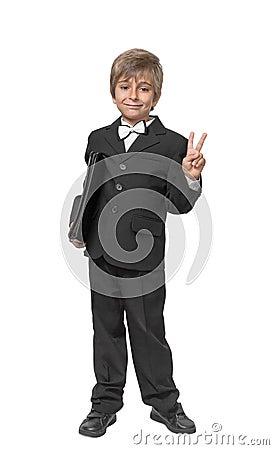 Boy in a tuxedo with a folder in hands.