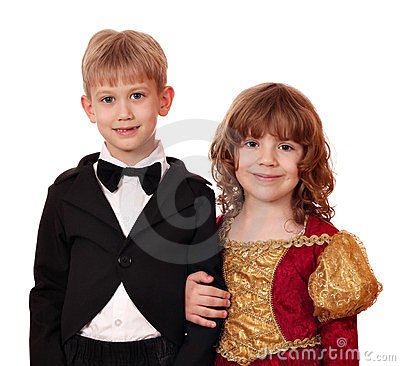 Boy in tuxedo and little girl in golden dress