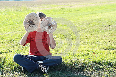 Boy with two parasol mushrooms