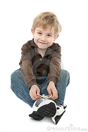 Free Boy Tying His Shoes Stock Photo - 17769340