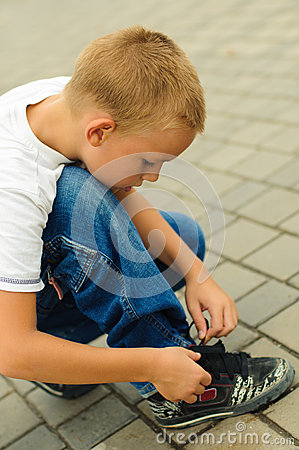 Free Boy Tying The Laces Stock Photography - 26812792