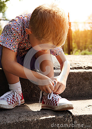Free Boy Tying The Laces On Sneakers Himself Royalty Free Stock Photo - 26200235
