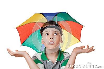 Boy with umbrella on head spread hands aside