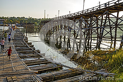 Boy use bamboo bridge crossing Editorial Image