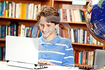 Boy Uses Computer in School