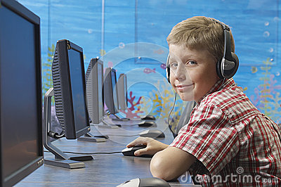 Boy Using Computer In Lab