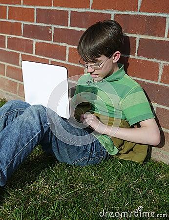 Boy Using Computer Outside School