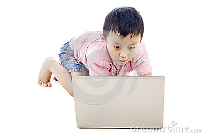 Boy using laptop seriously