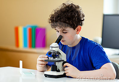 Boy Using Microscope Stock Photo - Image: 20263640