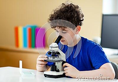 Boy using microscope