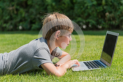 Boy using notebook at outdoor