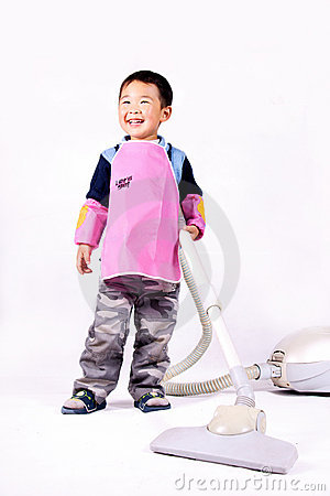 Boy and vacuum cleaner