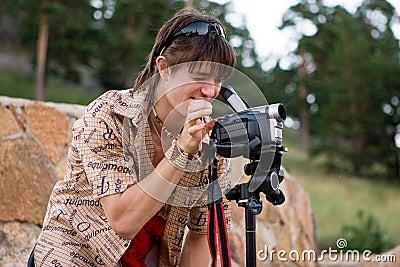 Boy with video camera on tripod