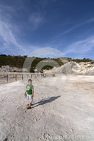 Boy at volcanic crater
