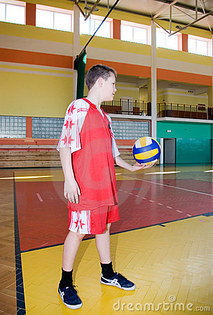 A boy with a volleyball.