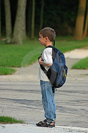 Boy Waiting on Bus
