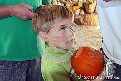 Boy waits in line to buy pumpkin