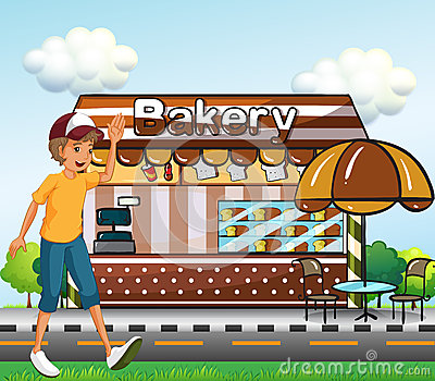 A boy walking across the bakery