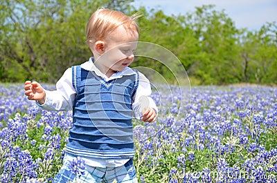 Boy Walking in Flowers
