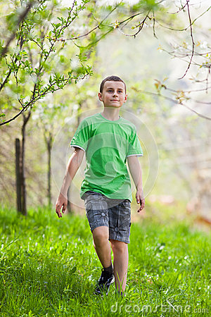 Boy walking outdoor