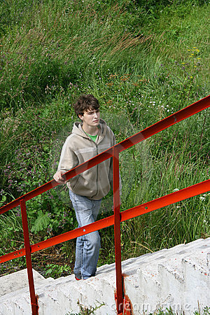 Boy walking up stairs outdoors