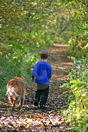 Free Boy Walking With Dog Stock Images - 1396744