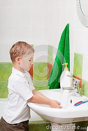 Boy washes