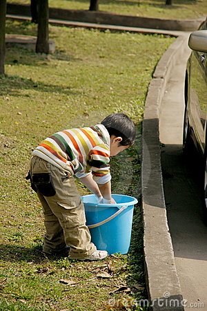 Boy Washing Car Stock Photo - Image: 8295150