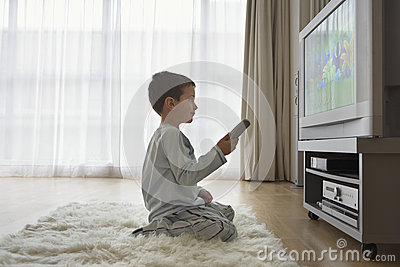Boy Watching Cartoons In TV