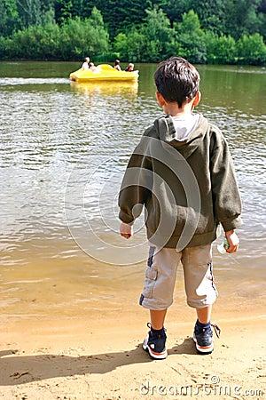 Free Boy Watching Pedalo In Lake Stock Image - 2636871