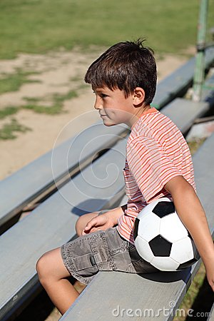 Boy watching a sports game