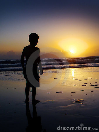 Boy watching sunrise
